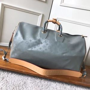 Other - Louis Vuitton Duffle bag Titanium